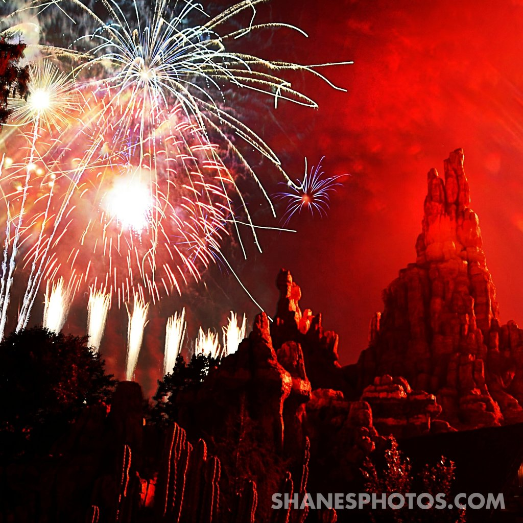 Fireworks behind Big Thunder Mountain at Disneyland