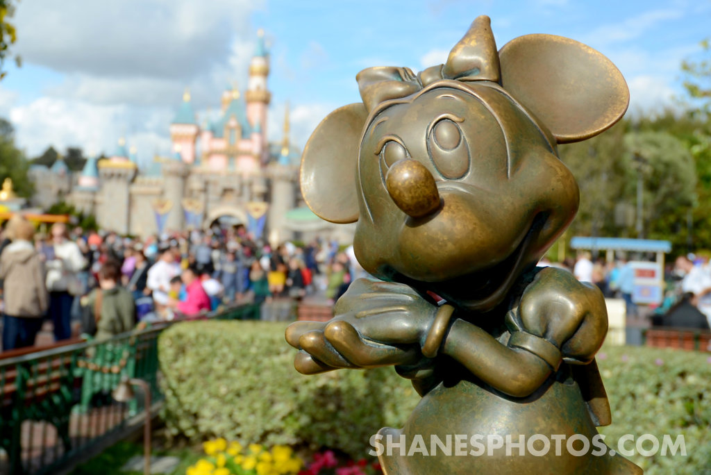 Minnie Mouse statue in front of Sleeping Beauty's Castle at Disneyland